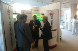 Mr. Steve Sawdon with visitors at the IIC Technologies stand, in IHO assembly, Monaco