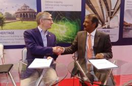 Mr. Nigel Clifford, CEO, Ordnance Survey International signing the MoU with Mr. Rajesh Alla, CMD, IIC Technologies.