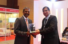 "Mr. Rajesh Alla, CMD IIC Technologies being presented with ""The Great Theodolite"" by Mr. Swarna Subba Rao, Surveyor General of India, at the Geospatial World Forum 2017."