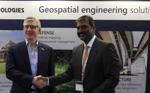 Ordnance Survey International and IIC Technologies signing an MoU